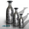 Graues Vasen mit Schneckenflecke