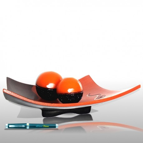 Orange and brown dish with balls